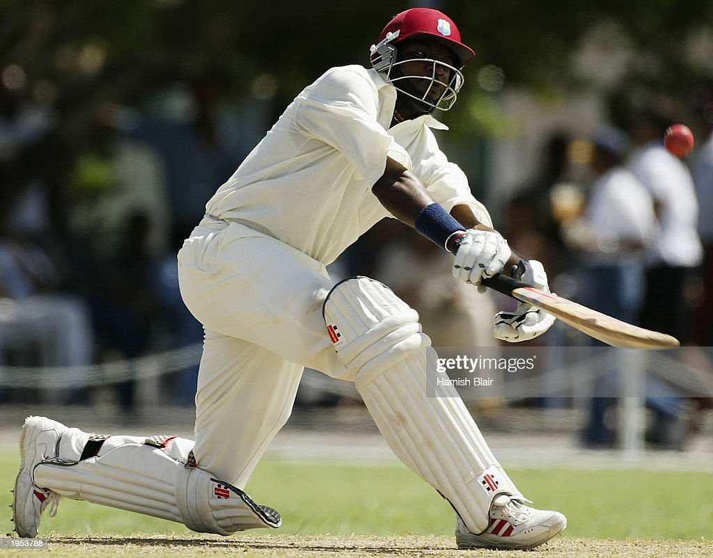 Chris Gayle of the University XI in action : News Photo