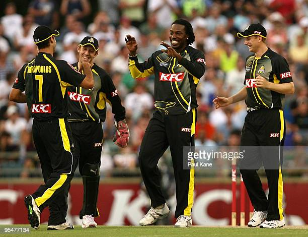 Chris Gayle of the Warriors celebrates the wicket of Mark Cosgrove during the Twenty20 Big Bash match between the West Australian Warriors and the...
