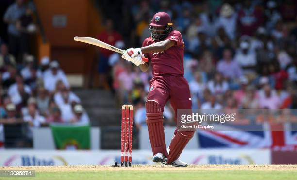 Chris Gayle of the West Indies bats during the 1st One Day International match between the West Indies and England at Kensington Oval on February 20...