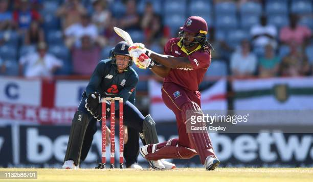Chris Gayle of the West Indies bats during the 4th One Day International match between the West Indies and England at Grenada National Stadium on...