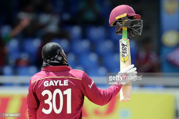 Chris Gayle of the West Indies brings up his 50 during the third MyTeam11 ODI between the West Indies and India at the Queen's Park Oval on August...