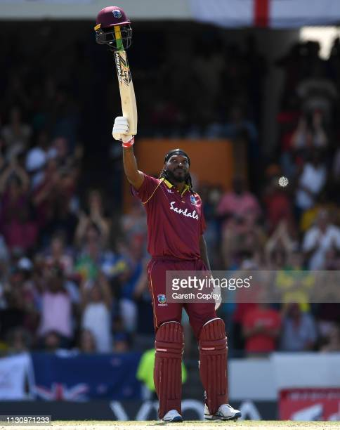 Chris Gayle of the West Indies celebrates reaching his century during the 1st One Day International match between the West Indies and England at...