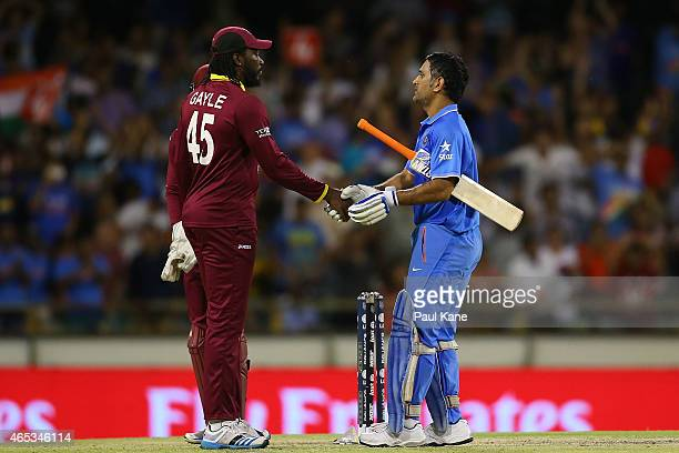 Chris Gayle of the West Indies congratulates MS Dhoni of India after winning the 2015 ICC Cricket World Cup match between India and the West Indies...