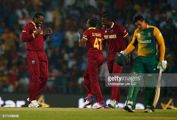 Chris Gayle of the West Indies dances in celebration with Dwayne Bravo of the West Indies after he takes the wicket of Rilee Rossouw of South Africa...