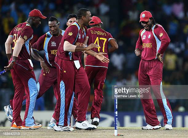 Chris Gayle of the West Indies dances with his team mates, after defeating Australia during the ICC World Twenty20 2012 Semi Final match between...