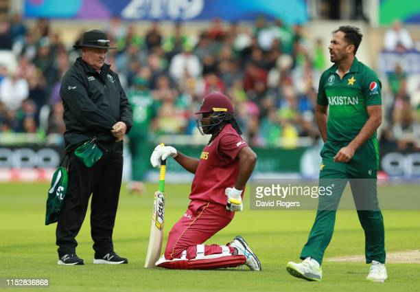 Chris Gayle of the West Indies grimaces after injuring his back during the Group Stage match of the ICC Cricket World Cup 2019 between the West...