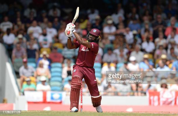 Chris Gayle of the West Indies hits a six during the first oneday international between the West Indies and England at Kensington Oval on February 20...