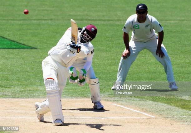 Chris Gayle of the West Indies hits ball to the boundary during day four of the Second Test match between New Zealand and the West Indies at McLean...