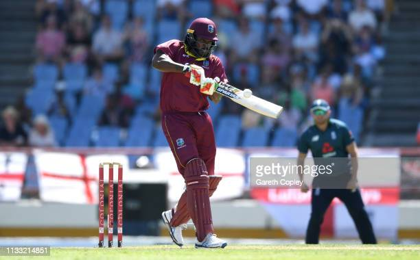 Chris Gayle of the West Indies hits out for six runs during the Fifth One Day International match between England and West Indies at Darren Sammy...