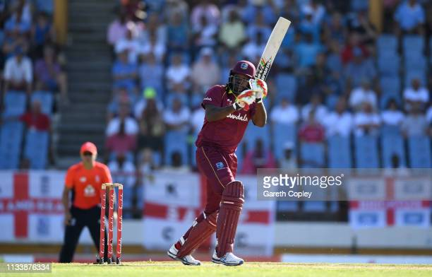 Chris Gayle of the West Indies hits out for six runs during the First Twenty20 International match between England and West Indies at Daren Sammy...