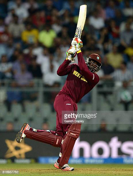 Chris Gayle of the West Indies hits out for six runs during the ICC World Twenty20 India 2016 Super 10s Group 1 match between West Indies and England...
