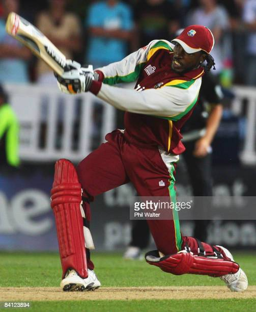 Chris Gayle of the West Indies hits the runs in the elimination over that won the match during the Twenty20 International match between New Zealand...