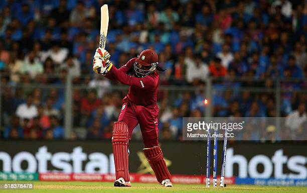 Chris Gayle of the West Indies is bowled by Jasprit Bumrah of India during the ICC World Twenty20 India 2016 SemiFinal match between West Indies and...