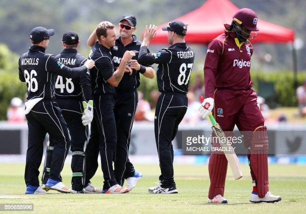 Chris Gayle of the West Indies is dismissed by New Zealand's Doug Bracewell during the first ODI cricket match between New Zealand and the West...