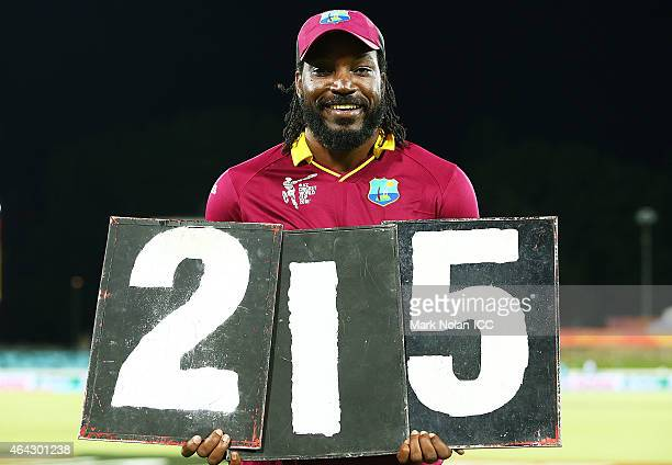 Chris Gayle of the West Indies poses with the scored board figures that represent his record breaking innings o 215 during the 2015 ICC Cricket World...