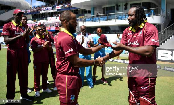 Chris Gayle of the West Indies presents John Campbell with his ODI cap ahead of the 1st One Day International match between the West Indies and...