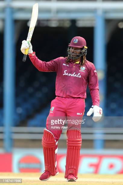 Chris Gayle of the West Indies salutes the crowd as he becomes the highest run scorer for the West Indies in ODIs during the second MyTeam11 ODI...