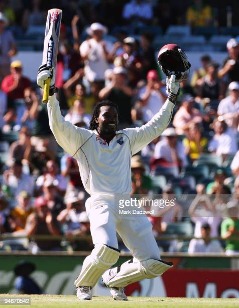 Chris Gayle of the West Indies sinks to his knees as he celebrates his century during day two of the Third Test match between Australia and the West...