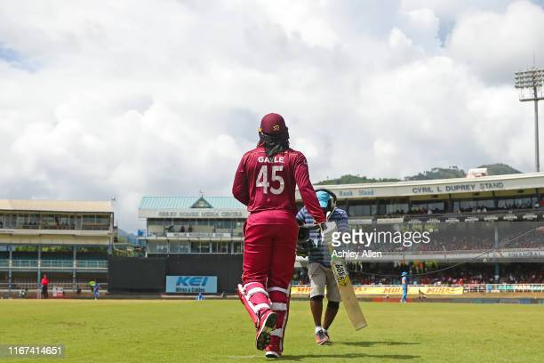 Chris Gayle of the West Indies walks out to bat in his 300th ODI during the second MyTeam11 ODI between the West Indies and India at the Queen's Park...
