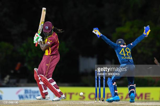 Chris Gayle of West Indies bowled by Lakshan Sandakan of Sri Lanka during the 3rd and final T20i match between Sri Lanka and West Indies at Coolidge...