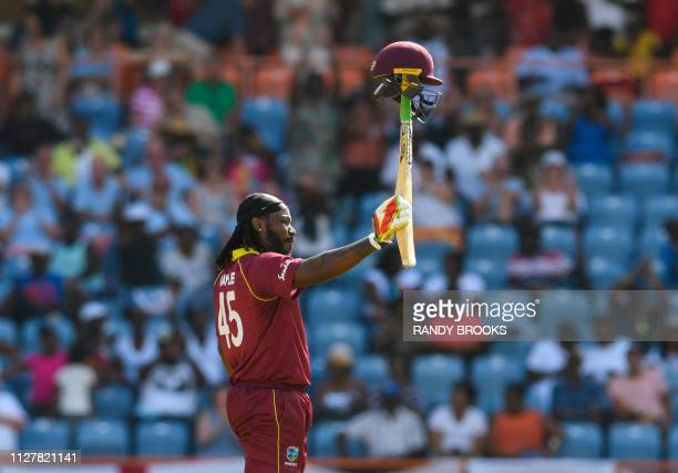 Chris Gayle of West Indies celebrates achieving 10000 ODI runs during the 4th ODI between West Indies and England at Grenada National Cricket Stadium...