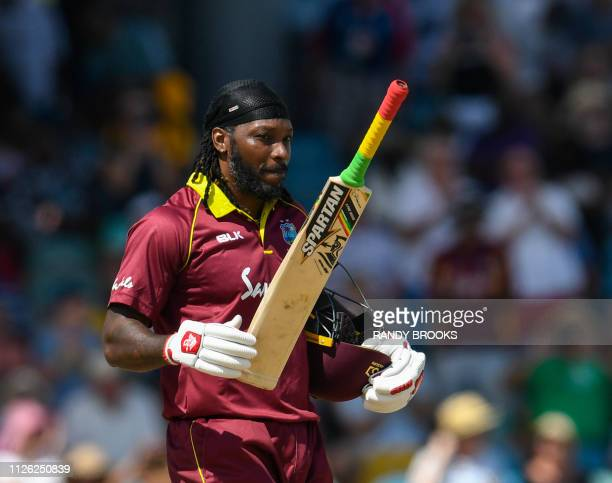 Chris Gayle of West Indies celebrates his century during the 1st ODI between West Indies and England at Kensington Oval Bridgetown Barbados on...