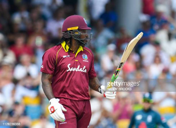 Chris Gayle of West Indies celebrates his half century during the 1st ODI between West Indies and England at Kensington Oval Bridgetown Barbados on...
