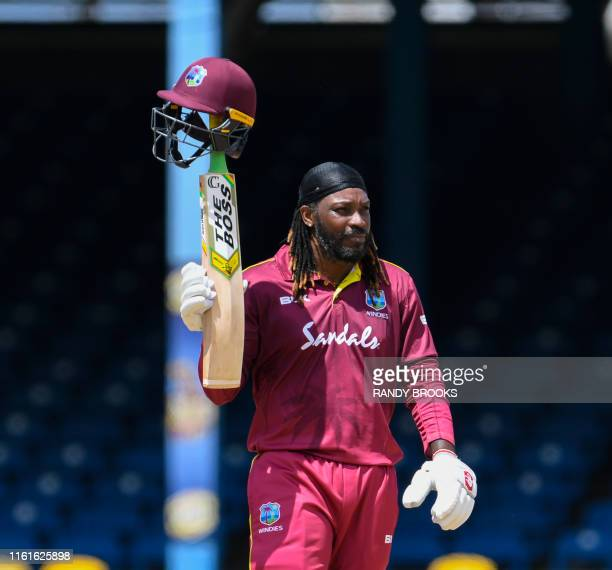 Chris Gayle of West Indies celebrates his half century during the 3rd ODI match between West Indies and India at Queens Park Oval, Port of Spain,...