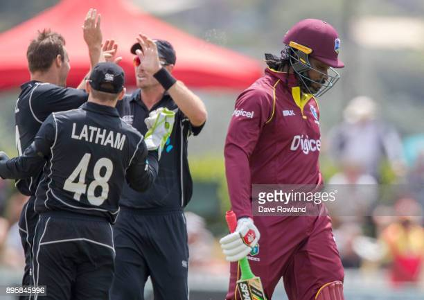Chris Gayle of West Indies departs as New Zealand celebrate taking his wicket during the first match in the One Day International series between New...