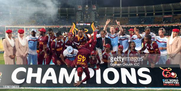 Chris Gayle of West Indies falls over the champions sign in celebration after defeating Sri Lanka in the ICC World Twenty20 2012 Final between Sri...
