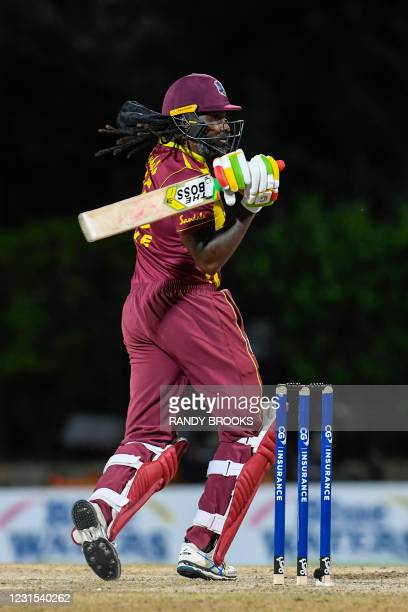 Chris Gayle of West Indies hits 4 during the 2nd T20i match between Sri Lanka and West Indies at Coolidge Cricket Ground on March 5, 2021 in Osbourn,...
