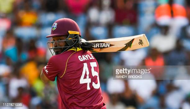 Chris Gayle of West Indies hits 4 during the 4th ODI between West Indies and England at Grenada National Cricket Stadium, Saint George's, Grenada, on...