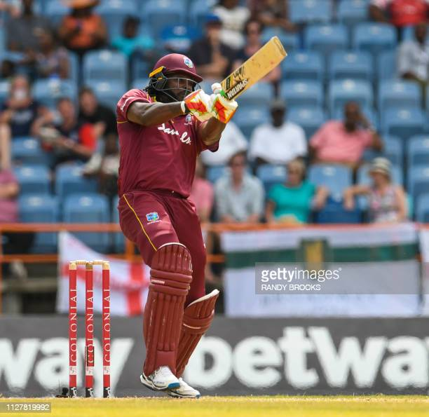 Chris Gayle of West Indies hits 6 during the 4th ODI between West Indies and England at Grenada National Cricket Stadium Saint George's Grenada on...