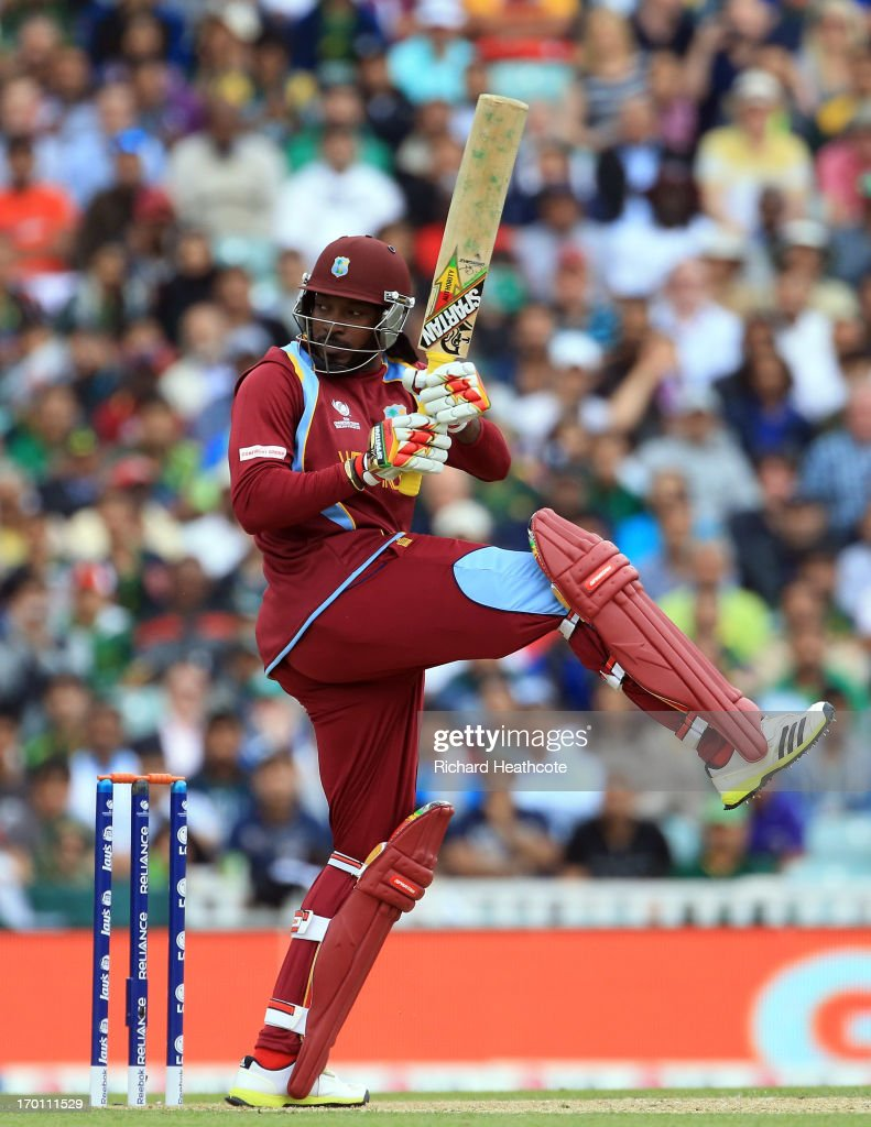 Chris Gayle of West Indies hits the ball to the boundary during the ICC Champions Trophy group B match between West Indies and Pakistan at The Oval on June 7, 2013 in London, England.