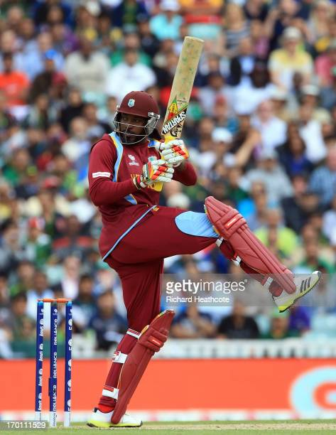 Chris Gayle of West Indies hits the ball to the boundary during the ICC Champions Trophy group B match between West Indies and Pakistan at The Oval...
