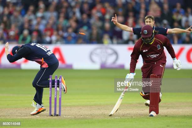 Chris Gayle of West Indies is run out from a direct Adil Rashidd throw during the third Royal London One Day International match between England and...