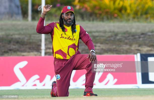 Chris Gayle of West Indies kneels in support of the black lives matter movement during the 2nd T20i match between Sri Lanka and West Indies at...