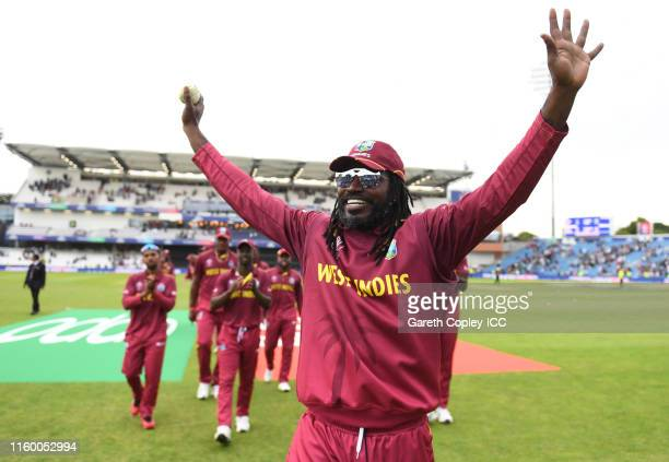 Chris Gayle of West Indies leads his side off on his final World Cup appearance during the Group Stage match of the ICC Cricket World Cup 2019...