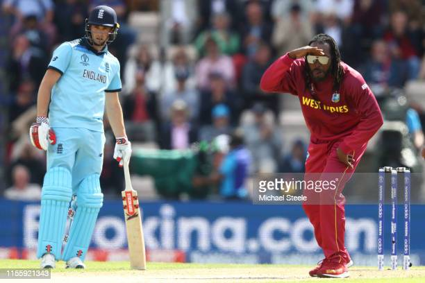 Chris Gayle of West Indies looks on after a delivery to Joe Root as Chris Woakes backs up during the Group Stage match of the ICC Cricket World Cup...