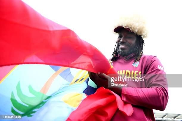Chris Gayle of West Indies signs autographs for fans after the Group Stage match of the ICC Cricket World Cup 2019 between Afghanistan and West...