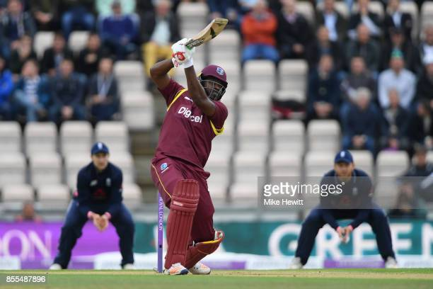 Chris Gayle of West Indies smashes a six over extra cover during the 5th Royal London One Day International between England and West Indies at Ageas...