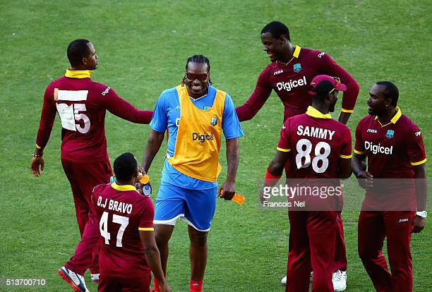 Chris Gayle of West Indies speaks to teammates during the T20 match between Birmingham Bears and West Indies at Dubai International Cricket Stadium...