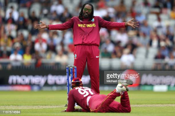 Chris Gayle of West Indies spreads his arms after a misfield from substitute fielder Fabian Allen during the Group Stage match of the ICC Cricket...