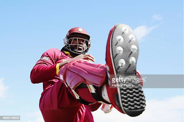 Chris Gayle of West Indies stretches prior to the 2015 ICC Cricket World Cup match between the West Indies and Ireland at Saxton Field on February 16...