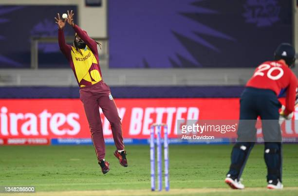Chris Gayle of West Indies takes the catch of Jason Roy of England during the ICC Men's T20 World Cup match between England and Windies at Dubai...