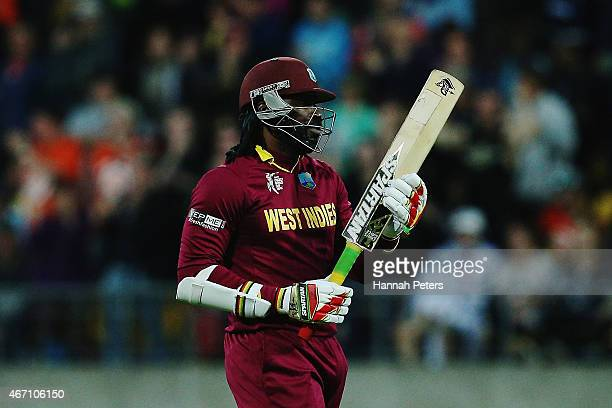 Chris Gayle of West Indies walks off after being dismissed by Adam Milne of New Zealand during the 2015 ICC Cricket World Cup match between New...