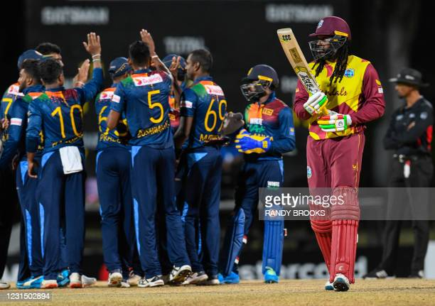 Chris Gayle of West Indies walks off the field dismissed by Akila Dananjaya of Sri Lanka during a T20i match between Sri Lanka and West Indies at...