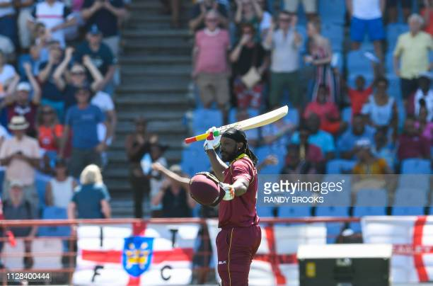 Chris Gayle of West Indies waves to supporters and fans during the 5th and final ODI between West Indies and England at Darren Sammy Cricket Ground...