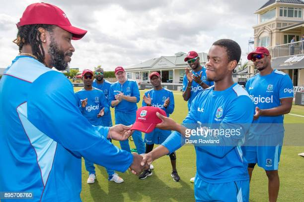 Chris Gayle presents Shimron Hetmyer of West Indies with his first cap before the first match in the One Day International series between New Zealand...