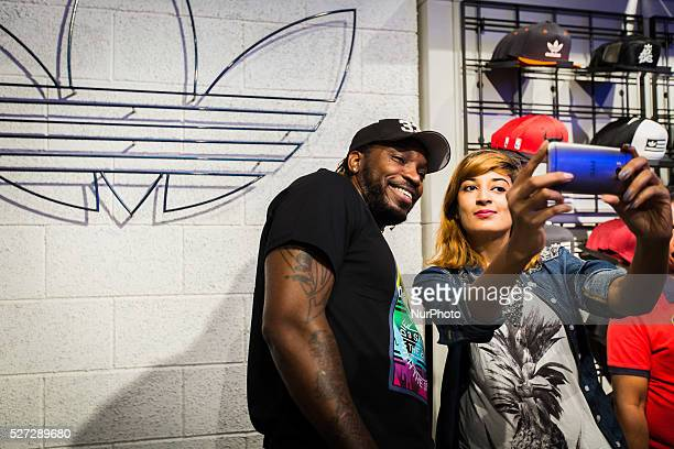 Chris Gayle take a selfie with fan at an event in Bangalore India ahead of the IPL match in the city Sunday May 1 2016 Gayle represents Royal...
